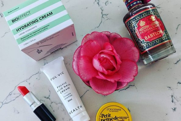 Outspoken Beauty products on a marble top